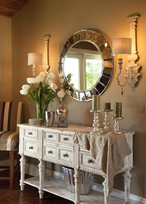 a refined whitewashed sideboard with vintage knobs and tall legs plus an open shelf for storage is a great idea to rock
