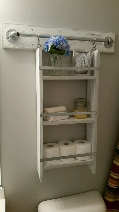 a small whitewashes hanging open shelf is a cool idea for a bathroom or any other small space in your home