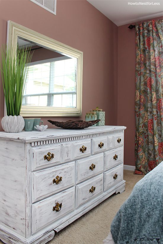 a vintage whitewashed dresser with elegant gold knobs is a very chic and stylish idea for a bright bedroom