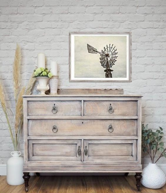 a vintage whitewashed sideboard on dark stained legs is a lovely idea for a beautiful and inspiring Scandi space