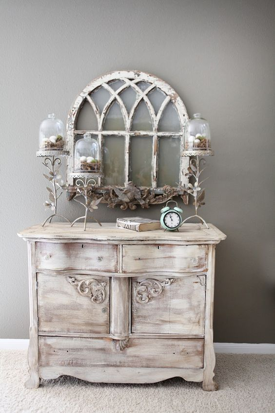 a vintage whitewashed sideboard with a very refined design is a chic idea for a shabby chic space and it looks amazing