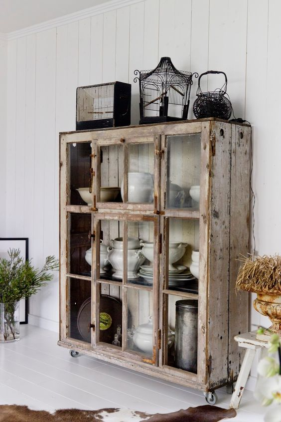 a whitewashed and brushed shabby chic storage unit with sliding glass doors is a very pretty and cool idea