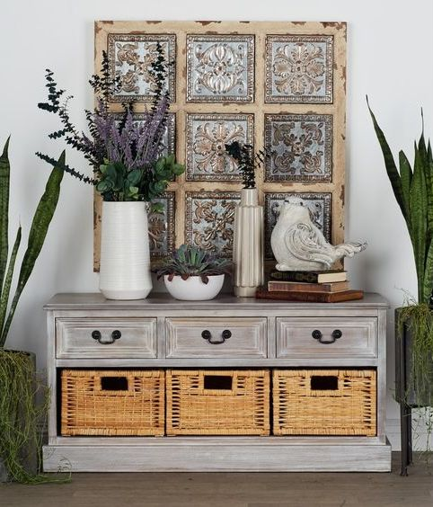a whitewashed storage unit with lots of drawers and baskets for storage is a stylish idea for a shabby chic or rustic space