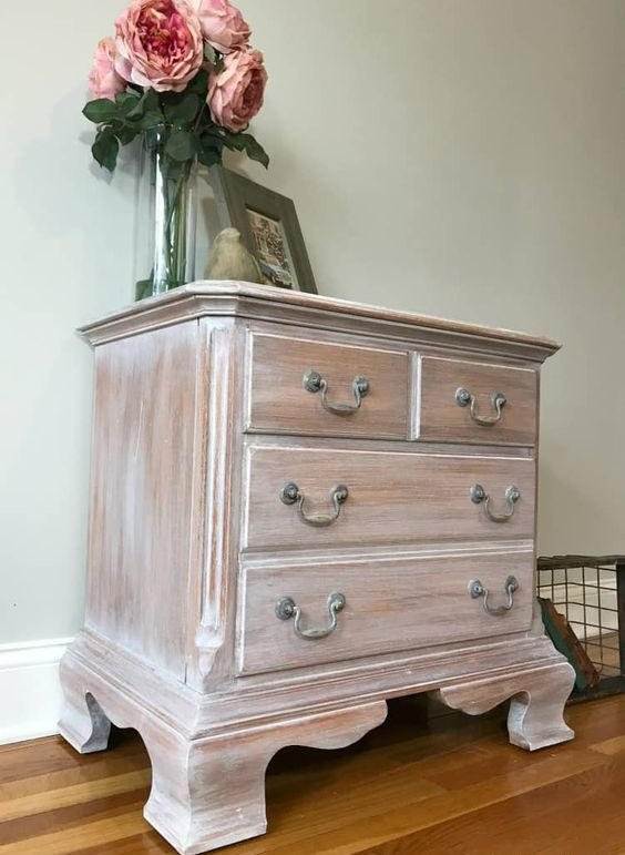 a whitewashed vintage sideboard on refined carved wooden legs is a lovely idea for a farmhouse space