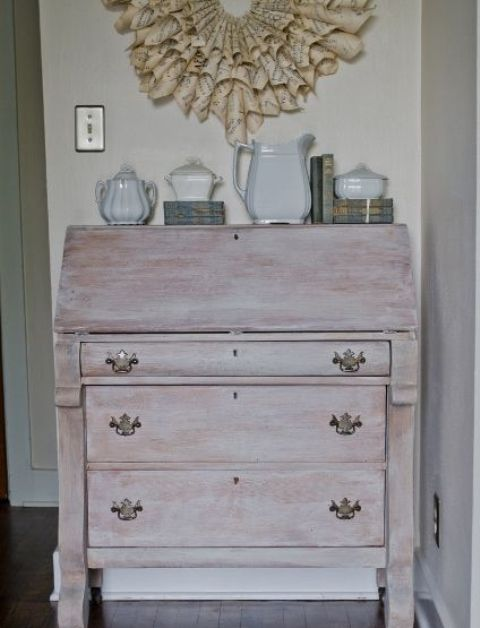a whitewashed vintage storage unit on casters and with vintage pulls is a lovely idea for a chic dining room or entryway