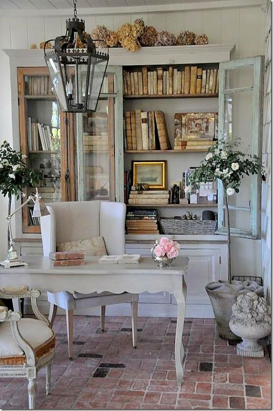 an oversized whitewashed bookcase with glass doors is a fantastic idea for a refined shabby chic home office
