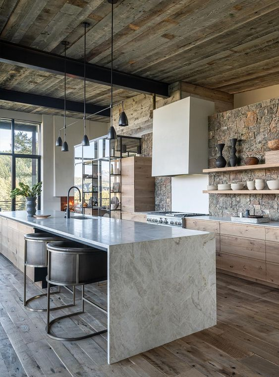 a contemporary chalet kitchen with a stone wall, a reclaimed wood ceiling, stone countertops and a modern black chandelier