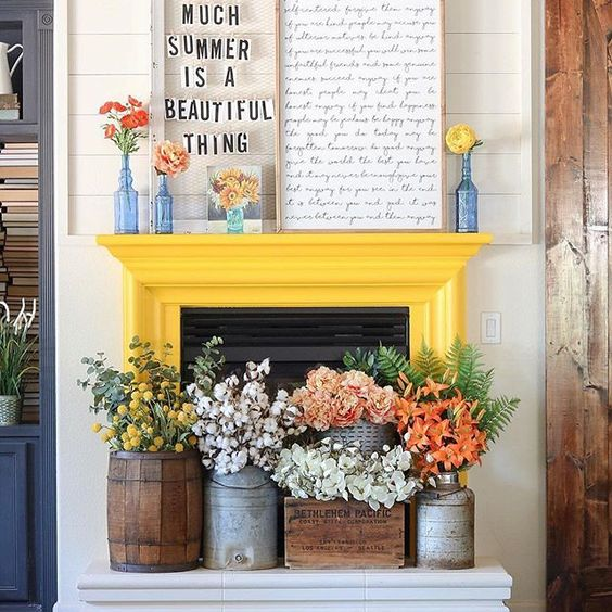 a couple of signs, bright blooms in vases and lush floral arrangements in crates and churns for summer decor