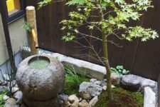 a lovely mini garden with pebbles, rocks, a stone bowl and a single small tree plus bamboo will refresh your backyard or courtyard