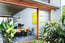 a lush inner courtyard that comprises a usual garden and an additional mini pond and a skylight