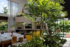 a lush tropical garden under a glass ceiling is what you need to create a luxh and relaxing courtyard