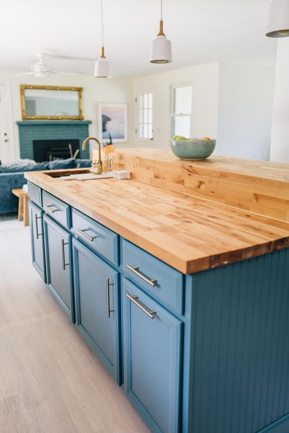 light stained butcheblock countertops contrast cold shades like this blue creating a stylish and bold look
