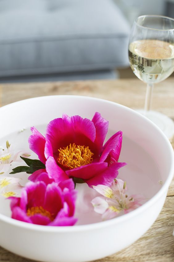 a bowl with floating bright blooms is a beautiful and simple summer centerpiece or decoration