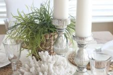 a coastal centerpiece of corals, grasses, candles in lovely candleholders is a very chic and cool idea to rock
