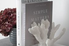 a faux coral as a book end is a lovely idea to slightly give a coastal feel to your home, a very stylish and cool way