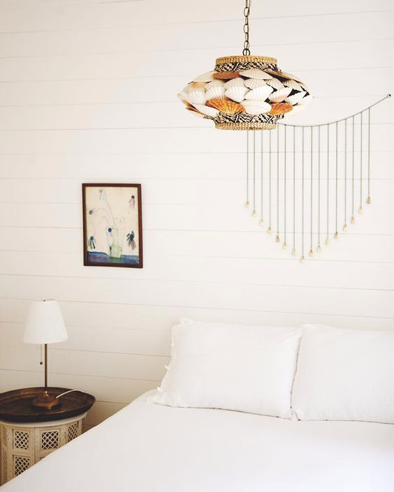 a pendant lamp of seashells and jute is a catchy and bold idea for a coastal space