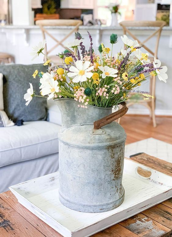 a vintage metal milkpot with wildflowers is a cool summer decoration for any space and it will add a rustic feel