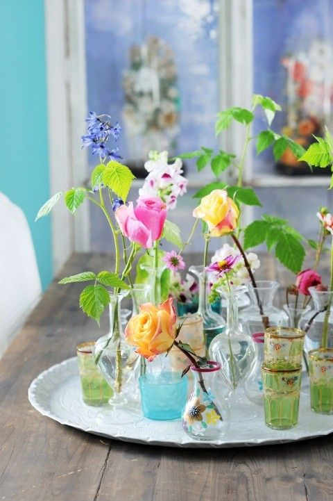 a vintage tray with elegant vases and glasses and bright blooms is a lovely summer decoration for any home