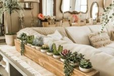 a wooden stand with plenty of planters and succulents of various kinds is a stylish idea for a console table