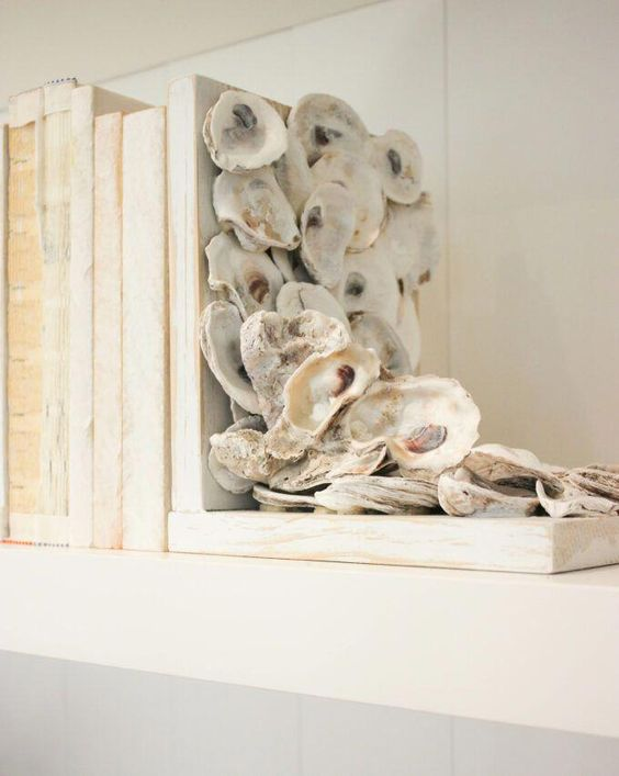 an oyster shellbookend is a cool idea to highlight your beachy decor and you can easily DIY it