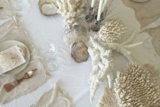 corals lining up the table will give a coastal feel to it and will make the space look relaxed and seaside-like