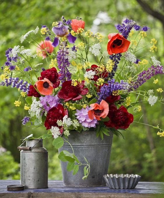 place your colorful floral arrangement into a simple metal bucket to make your summer decor bright and fun