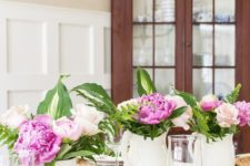 white porcelain milk jugs with hot pink and blush blooms are a lovely rustic summer decoration