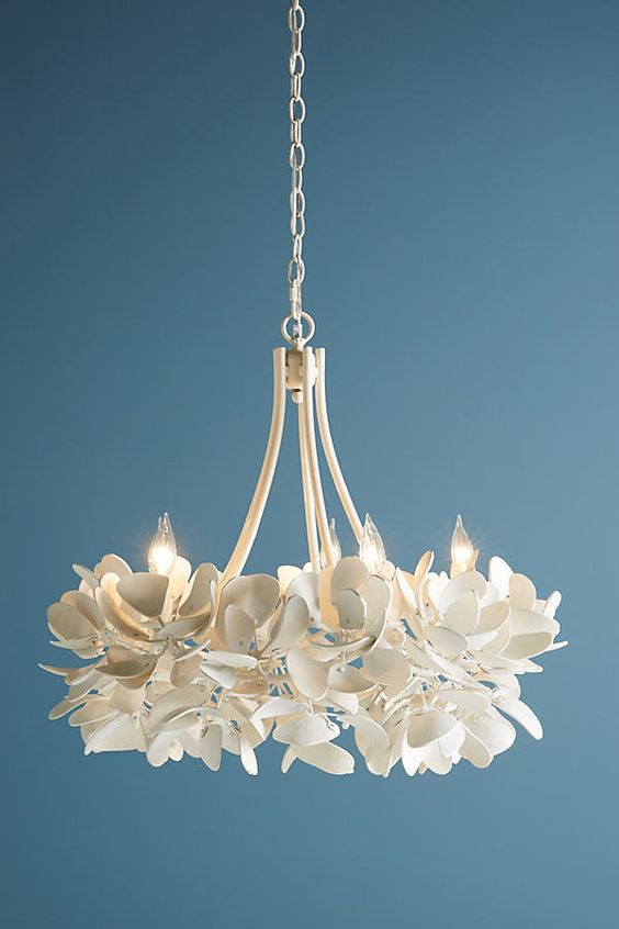 a beautiful white magnolia chandelier will bring an ethereal touch and chic to your space