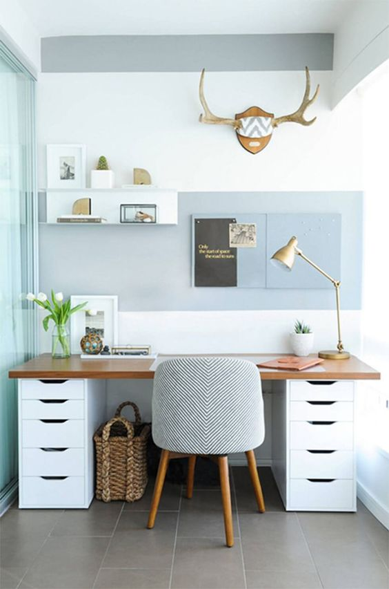 a breezy beach home office in grey and white, with a cool and comfy desk, a striped chair, a shelf on the wall