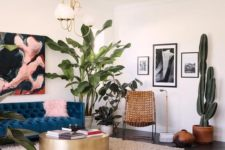 a bright artwork, pink pillows, lots of potted plants here and there make the living room fele like summer