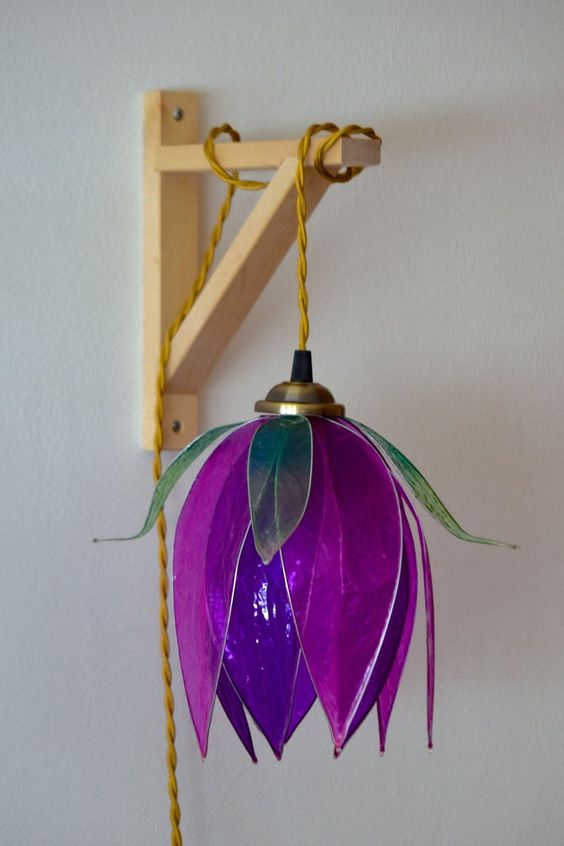 a bright purple flower-shaped pendant lamp will bring much color and a strong natural feel to your space