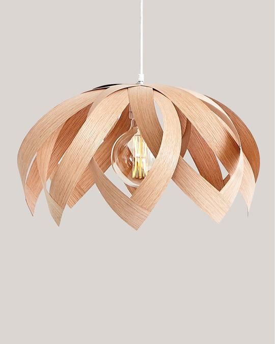 a chic and simple plywood flower pendant lamp is a very creative piece to rock in a modern interior