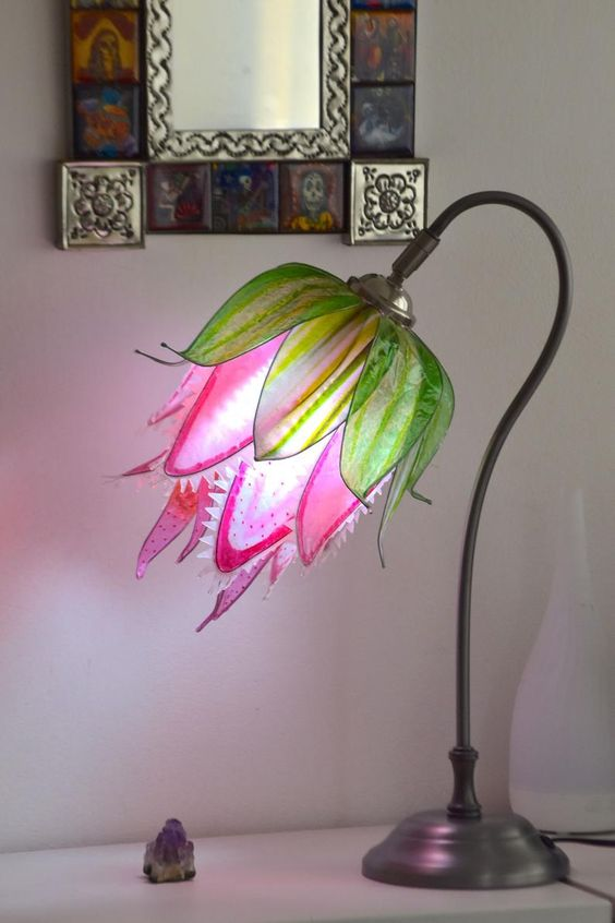 a colorful table lamp that shows off a predator flower in hot pink and green is a cool and bright idea