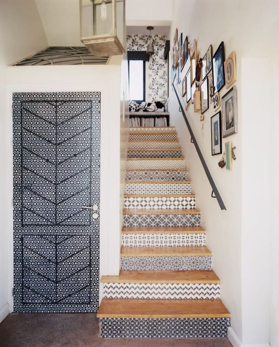 a creative beachy staircase with risers clad with blue patterned tiles is a lovely idea for a seaside home