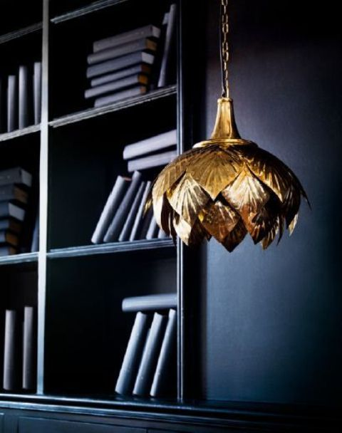 a gold flower-shaped pendant lamp is a refined and chic addition to any interior