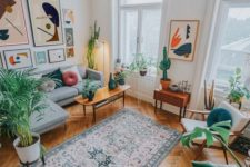 a mustard chair, bright artworks and potted plants here and there will make your living room feel like summer