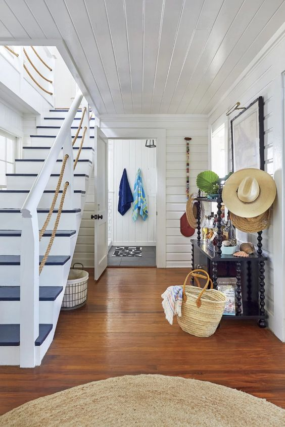 a nautical painted staircase with rope railing is a chic and bold idea to rock and it brings a stylish touch to the space