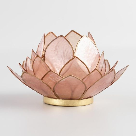 a pink lotus-inspired table lamp with a gold edge is very chic and very refined, it will give a natural feel to your space