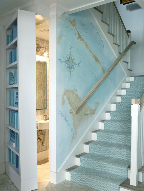 a seaside staircase covered with light blue printed carpet covering the steps is a pretty and easy idea to realize