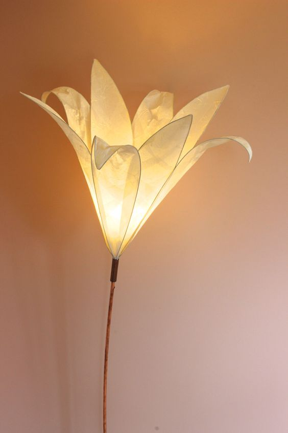 a simple flower-shaped neutral lamp like this one will unobtrusively make your interior more nature-infused