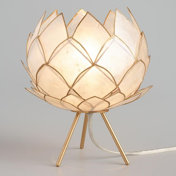 a super elegant neutral flower-shaped table lamp with a gold edge will bring chic to your space