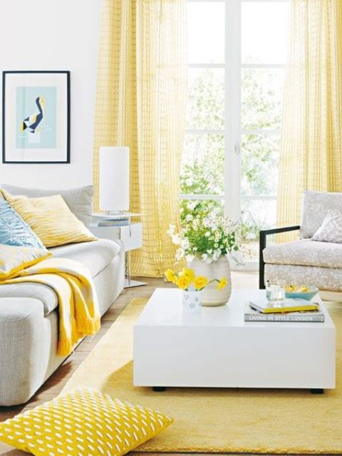 a vivacious living room with yellow curtains, a rug and some pillows feels sun-filled and very bright