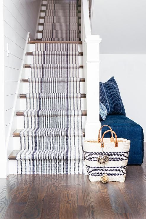 a white staircase made nautical with just some striped nautical carpet covering it is a cool idea