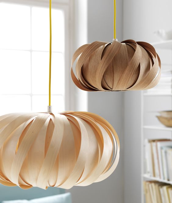 pretty plywood pendant lamps in blush and brown resemble flowers and add a beautiful and soft touch to the space