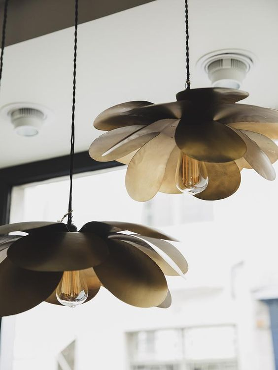 statement pendant lamps with large petals will bring a natural feel to any modern space without looking too whimsy