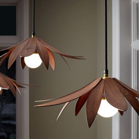 veneer lotus pendant lamps in a rich tone of wood are a chic addition to a modern interior