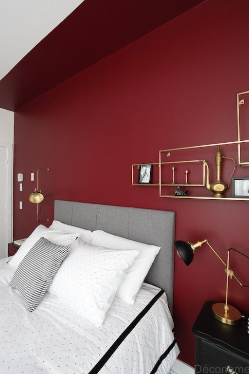 a burgundy statement wall is a bold idea for a bedroom and it's actual not only in the fall