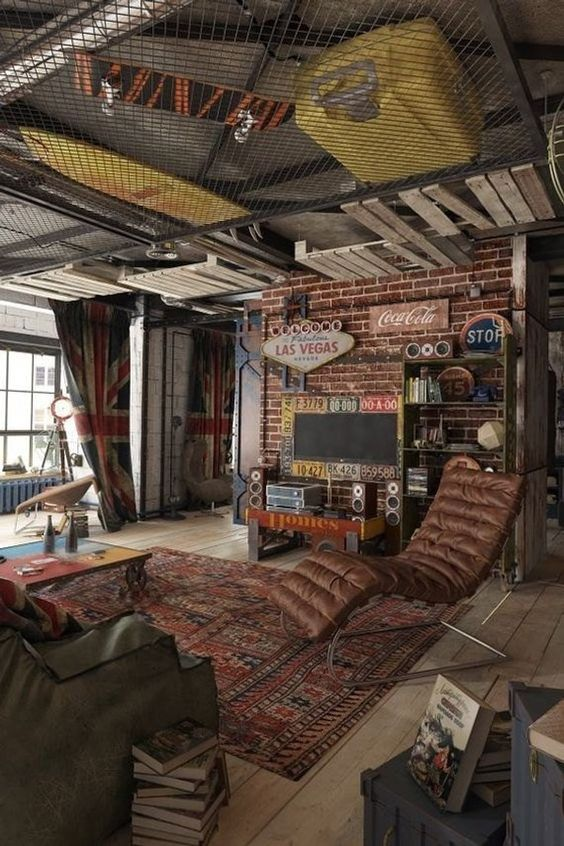 a colorful industrial living room with brick walls, leather furniture, a net ceiling with storage