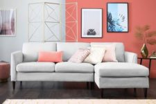 a contemporary laconic living room with a dove grey sofa, a geometric screen, artworks, a printed rug and coffee tables
