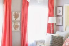 a living room with dove grey walls, coral curtains and pillows, a creamy sofa and white coffee tables